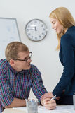 Friends having affair at work Royalty Free Stock Photography