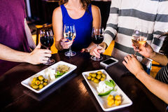 Friends having an aperitif with wine. In a bar royalty free stock photos