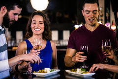 Friends having an aperitif with wine. In a bar royalty free stock image