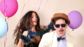 Friends having awesome time dancing in photo booth stock footage