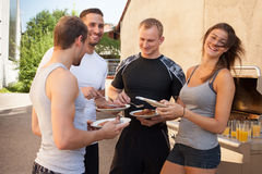 Friends having a barbecue after fitness work out Stock Image