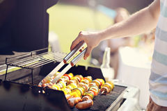 Friends having barbecue party in backyard Royalty Free Stock Photography