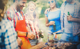 Friends having a barbecue party in nature stock photography