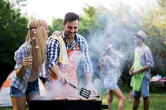 Friends having a barbecue party in nature. While having fun royalty free stock images