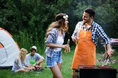 Friends having a barbecue party in nature. While having fun stock images