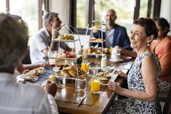 Friends having breakfast at a hotel royalty free stock image