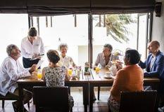 Friends having breakfast at a hotel stock photos
