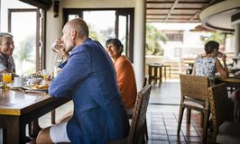 Friends having breakfast at a hotel royalty free stock photos