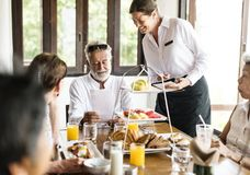 Friends having breakfast at a hotel royalty free stock photography