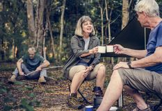 Friends having coffee at a campsite stock photos