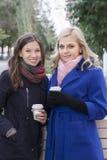 Friends having coffee outdoors Stock Photo