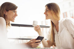 Friends having coffee and talking Royalty Free Stock Photos