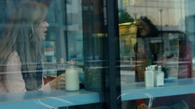 Friends having coffee together in cafe stock video footage