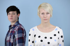 Friends having a conflict. Jealousy or envy Royalty Free Stock Photography