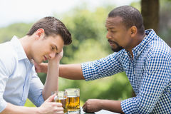 Friends having a conversation while having beer Royalty Free Stock Image