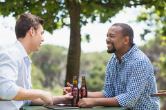 Friends having a conversation while having beer. In the restaurant Royalty Free Stock Photography