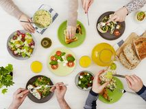 Friends having dinner. People at dinner table from above stock image
