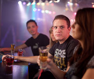 Friends having a drink. In a disco Royalty Free Stock Photography