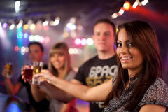 Friends having a drink. In a disco Stock Photos