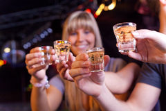 Friends having a drink. In a disco Royalty Free Stock Image