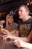 Friends having a drink. In a disco Royalty Free Stock Images