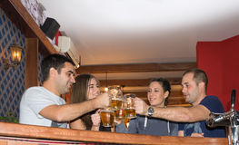 Friends having drinks in a bar.  royalty free stock photo