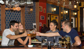 Friends having drinks in a bar royalty free stock images