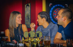 Friends having drinks in a bar Royalty Free Stock Photo
