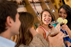 Friends having drinks Stock Images