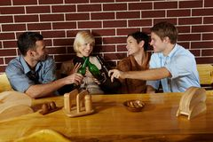 Friends having fun at bar Royalty Free Stock Images