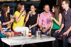 Friends having fun at a bar Royalty Free Stock Photos