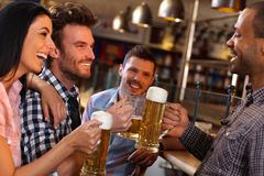 Friends having fun in bar Royalty Free Stock Images