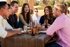 Friends having fun at a bar Royalty Free Stock Photography