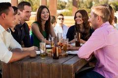 Friends having fun at a bar royalty free stock photography