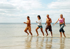 Friends having fun at the beach Royalty Free Stock Photography
