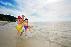 Friends having fun by the beach Royalty Free Stock Photos