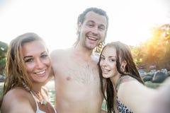 Friends having fun on the beach Royalty Free Stock Photos