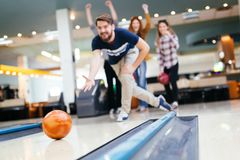 Friends having fun while bowling Stock Image