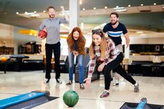Friends having fun while bowling Royalty Free Stock Photos
