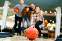 Friends having fun while bowling. And speding time together Stock Photos