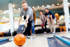 Friends having fun while bowling Royalty Free Stock Image