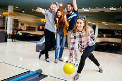 Friends having fun while bowling Stock Photography