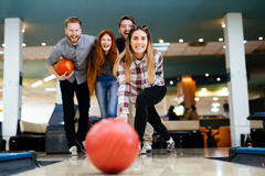 Friends having fun while bowling Royalty Free Stock Photo