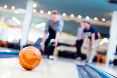 Friends having fun while bowling Stock Photos