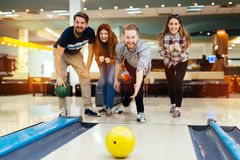 Friends having fun while bowling. And speding time together Stock Photo