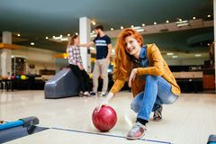 Friends having fun while bowling Royalty Free Stock Photography