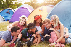 Friends having fun on the campsite at a music festival Royalty Free Stock Photo