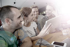 Friends having fun on campus with tablet Royalty Free Stock Photos