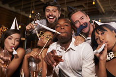 Friends having fun celebrating New Year at a bar, close up Stock Photo