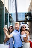 Friends having fun in the city shopping tourism enjoying together stock images